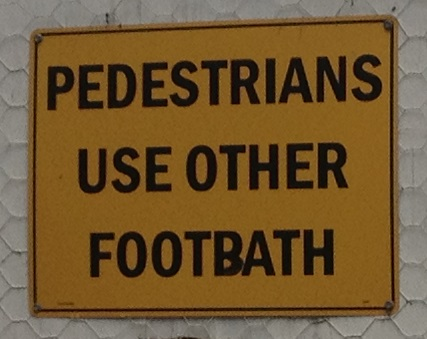 Pedestrians use other footbath